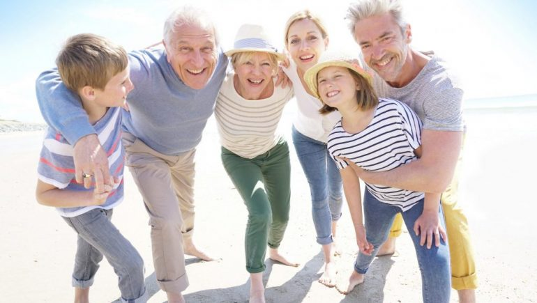 Portrait of happy multi-generational family having fun on the beach.